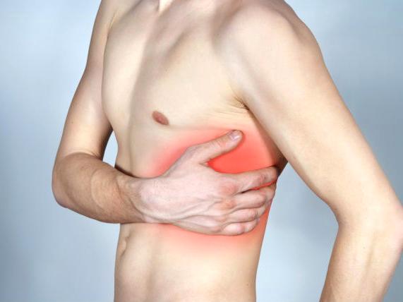 Что делать если болит под ребрами слева